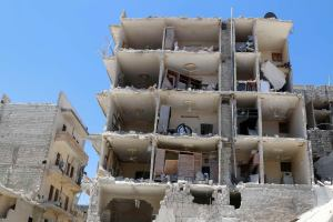 A damaged building is pictured at a site hit by what activists said were two barrel bombs dropped by forces loyal to Syria's President Bashar al-Assad in al-Katerji district in Aleppo May 18, 2014. REUTERS/Hosam Katan (SYRIA - Tags: POLITICS CIVIL UNREST CONFLICT)