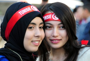 Tunisian girls attend a rally to mark the fifth anniversary of the Arab Spring, Thursday, Jan.14, 2016 in Tunis. Tunisian teachers, activists and political parties have joined to celebrate five years since protesters drove out their autocratic president and ushered in a democratic era. The crowd at Thursday's rally included families of those killed in weeks of protests against President Zine el Abidine Ben Ali, who fled on Jan. 14, 2011. (AP Photo/Riadh Dridi)
